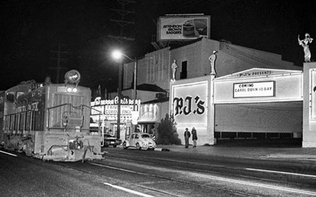 February 1970: Southern Pacific freight train passes P.J's on Santa Monica Blvd. in West Hollywood