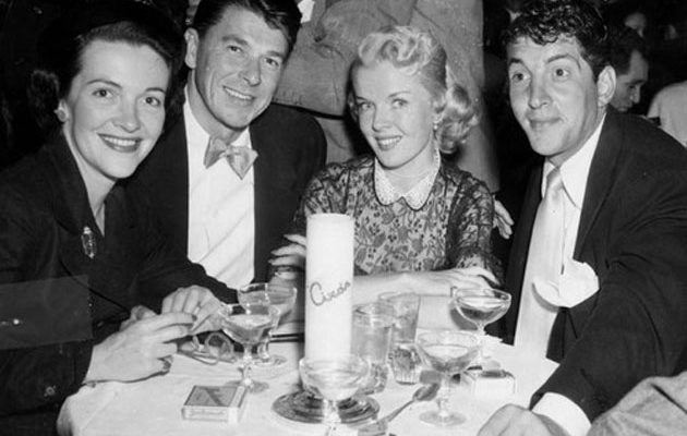 Celebrating the upcoming marriage of Nancy Davis (left) to Ronald Reagan, are Jeanne (Biegger) Martin and Dean Martin (right) at Ciro's Nightclub on the Sunset Strip on February 23, 1952.